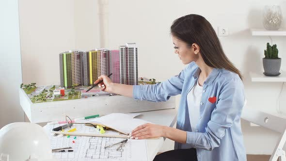 Young Professional Architect Concentreated on Working in Office.