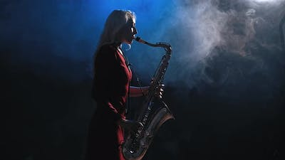 Woman Plays On Saxophone Jazz Melody