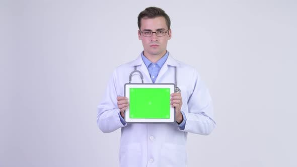 Thumbnail for Young Happy Handsome Man Doctor Showing Digital Tablet