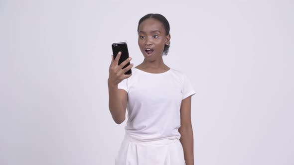 Thumbnail for Young Stressed African Woman Showing Phone and Shouting