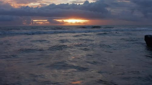 Retreating View of Waves on the Ocean During Sunset