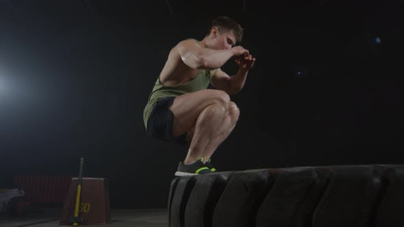 Thumbnail for Sportsman Jumping on Tire During Workout