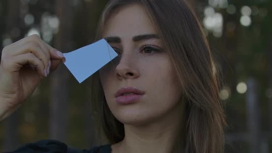 Thumbnail for Portrait of a Caucasian Girl Holding Fragment of Broken Mirror. Blue Sky Reflecting in the Crack