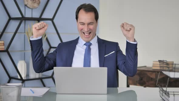 Cover Image for Excited Businessman Celebrating Success at Work