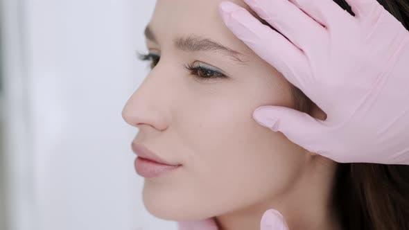 Closeup of Woman Having Facial Massage in Beauty Salon