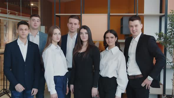 Portrait of a Group of Students Who are in the Room and Smiling at the Camera