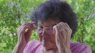 senior woman wearing eyeglasses