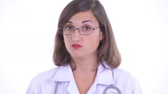 Thumbnail for Face of Serious Woman Doctor Nodding Head No