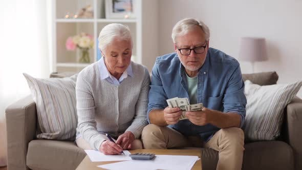 Thumbnail for Senior Couple with Money and Bills at Home 27