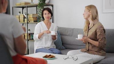 Three Women Chatting at Home