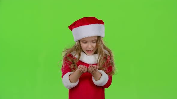 Thumbnail for Child Girl in the Christmas Costumes Inflate the Stellar Pollen, Green Screen