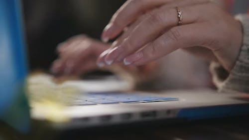 Closeup of Hands of a Woman Engineer Working for a Laptop
