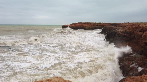 Large Storm Waves Crashing on Rocks in Slow Motion