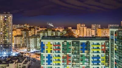 residential buildings in the night city, apartments and apartments. timelapse of the night city