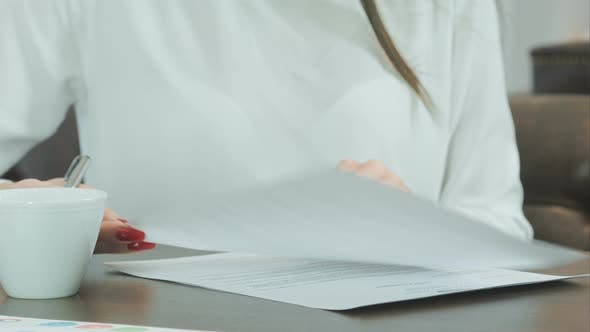 Thumbnail for Woman Hand with Red Nails Signing Formal Papers