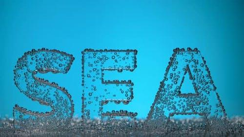 Word Sea Underwater in Oxygen Bubbles on Blue Background