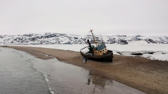 Thumbnail for Abandoned old ship on a sandy shore