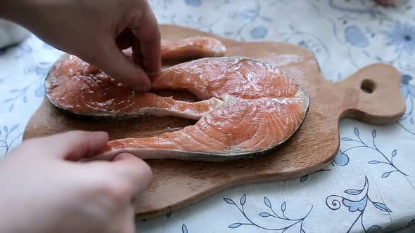 Salmon fry in pan. Cooking salmon steak.