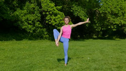 Young Woman Doing Sports at Nature