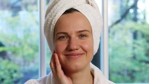 Portrait of a Beautiful Young Woman With a Towel Turban on Her Head