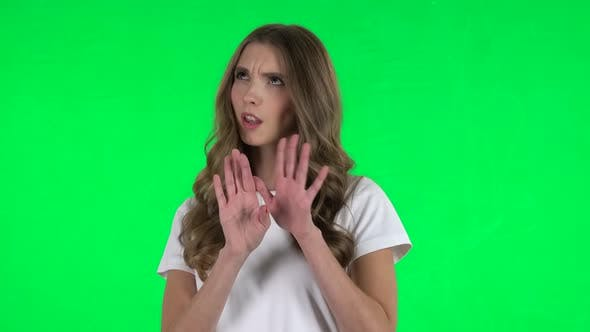 Thumbnail for Lovable Girl Negatively Waving Her Head Expressing She Is Innocent. Green Screen