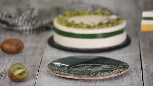 Thumbnail for Piece of homemade mousse cake with kiwi.
