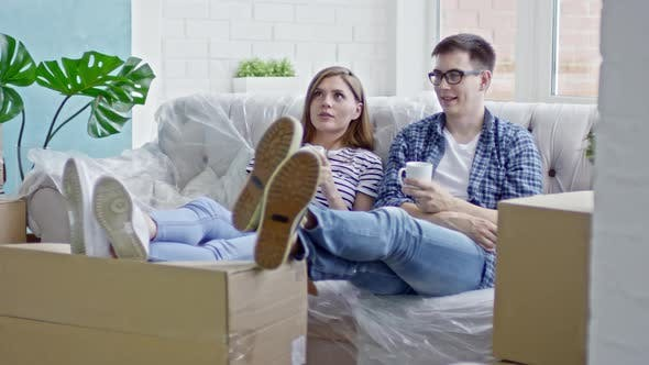 Thumbnail for Couple Relaxing in New Flat