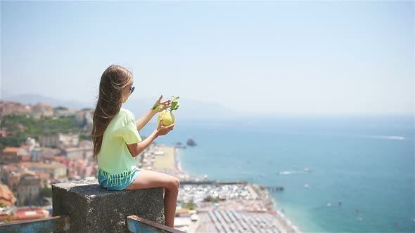 Thumbnail for Big Yellow Lemon in Hand in Background of Mediterranean Sea and Sky.