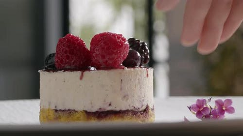 An Appetizing Dessert with a Handful of Berries on the Top