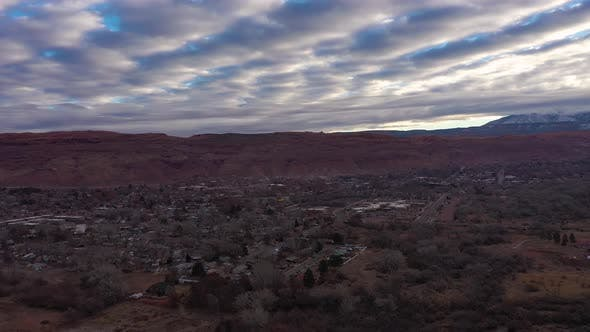Moab City and Distant Mountains on Cloudy Morning