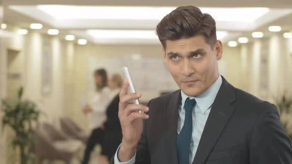 Thumbnail for Annoyed Businessman Listening To Yelling in Smartphone. Portrait of Irritated Young Caucasian Man