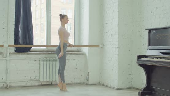 Thumbnail for Ballet Dancers Practicing Relevelent at Barre