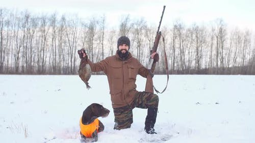 Young Active Hunter Showing His First Fowl