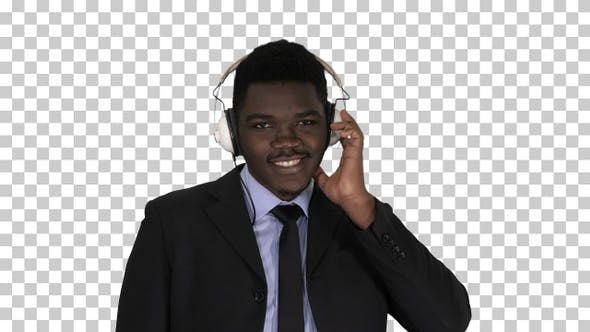 Thumbnail for Handsome Afro American businessman in headphones is listening