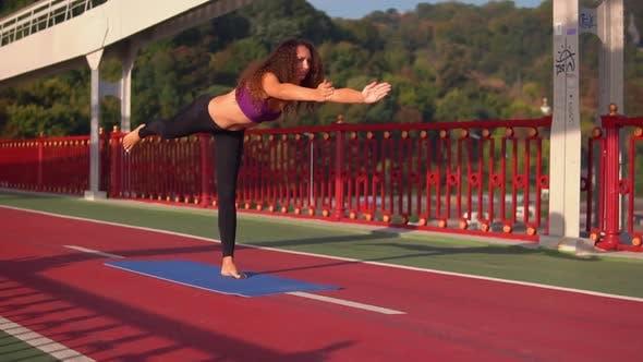 Thumbnail for Girl Doing Asana at Sunset