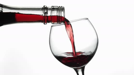Thumbnail for Rose Wine. Red Wine Pour in Wine Glass Over White Background