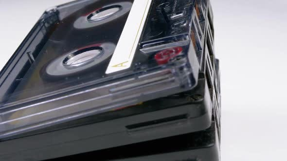 Thumbnail for A Stack of Audio Tapes Rotates on a White Background
