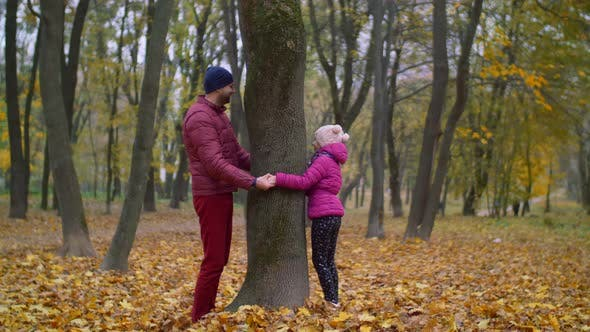 Thumbnail for Joyful Father and Kid Playing Hide and Seek in Autumn