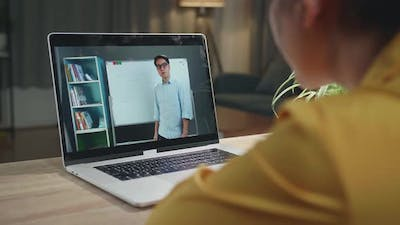 Girl Student Distance Learning With Online Teacher On Computer Screen