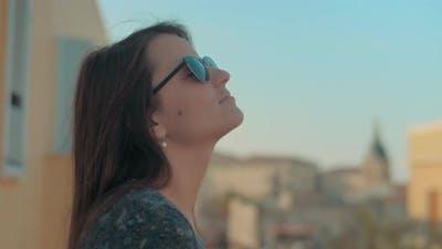 Woman breathing european summer air