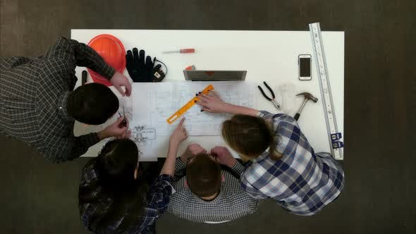 Thumbnail for Young Architects Checking Drawing Measurements with Divider