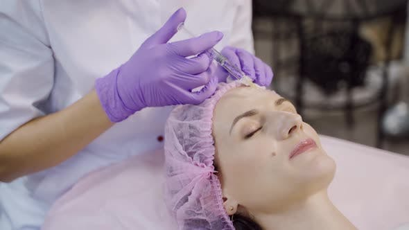 Beautiful Woman is on the Procedure of Facial Rejuvenation