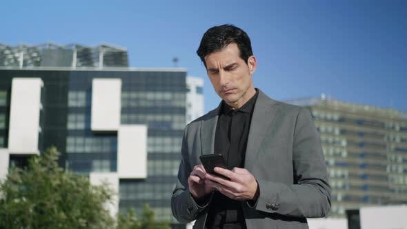 Thumbnail for Businessman Texting on Cellphone at Street. Professional Working on Smartphone
