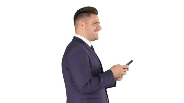 Thumbnail for Mature businessman using mobile phone texting message on