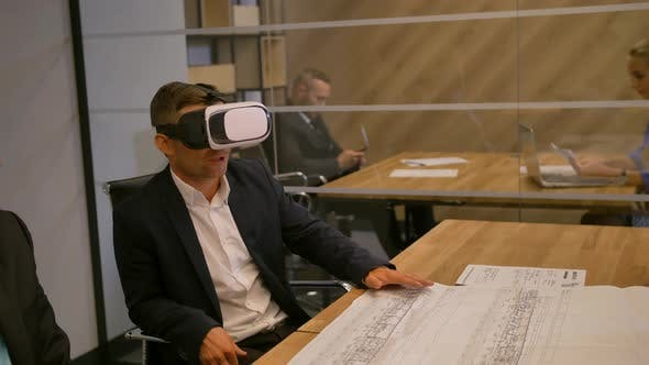 Businessman and His Colleagues Working with Virtual Layout Future Technology Concept and Drawing