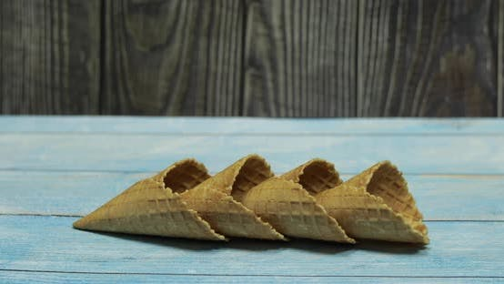 Thumbnail for Ice Cream Cones, Isolated on Blue Wooden Surface. Waffles for Ice Cream