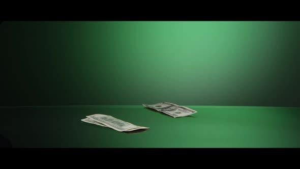 American $100 Bills Falling onto a Reflective Surface - MONEY 0008
