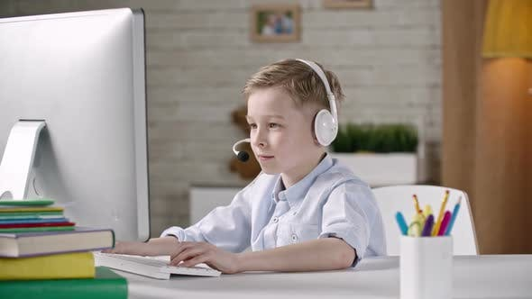 Kid Using Computer for Communication