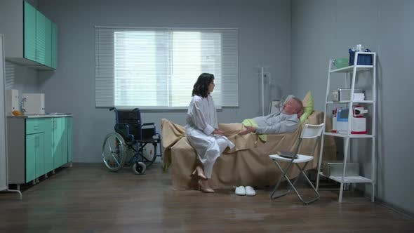 Doctor Sit and Talk with Patient in Hospital