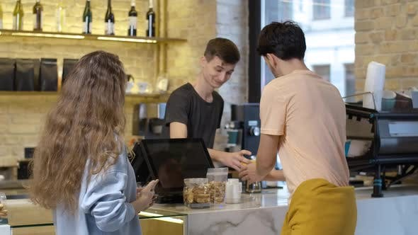 Positive Millennial Caucasian Couple Buying Coffee and Leaving